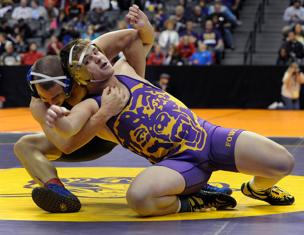 . DENVER, CO. - FEBRUARY 21: Fowler senior Chance Chambers, right, struggled against Lyons freshman Jon Hickman, left, in a 170-pound bout in class 2A Thursday. The CHSAA State Wrestling Tournament kicked off Thursday, February 21, 2013 at the Pepsi Center in Denver. (Photo By Karl Gehring/The Denver Post)