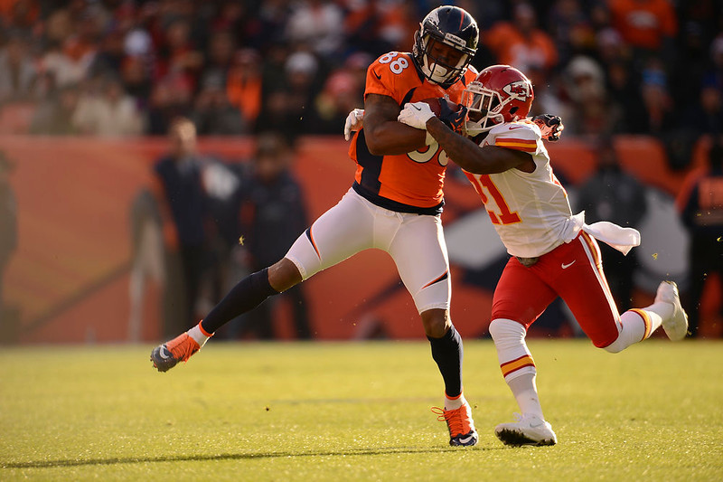 . Denver Broncos wide receiver Demaryius Thomas (88) is tackled by  Kansas City Chiefs cornerback Javier Arenas (21) as the Denver Broncos took on the Kansas City Chiefs at Sports Authority Field at Mile High in Denver, Colorado on December 30, 2012. John Leyba, The Denver Post