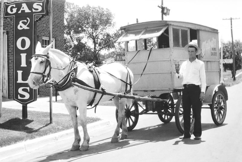 George Glines with his milk wagon - wonder what the mule's name was...
