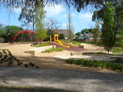 sandpit with sandstone block edging and sandstone block retaining and slide on mount and hexagonal climbing