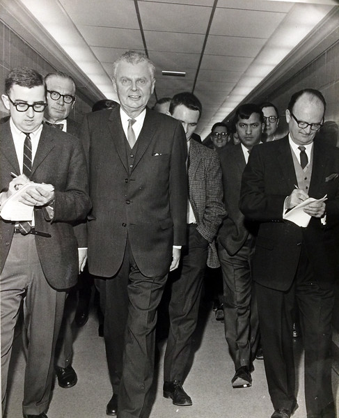 """Diefenbaker and gallery reporters, Feb. 5, 1965. """"After PC Caucus in tunnel""""Bob Hull, Richard Jackson, John Diefenbaker, Richard Gwyn and Victor Mackie (Source: Victor Mackie Fonds, Library and Archives Canada/BibliothËque et Archives Canada. Victor Mackie was a Winnipeg Free Press correspondent/Victor Mackie Ètait correspondent du Winnipeg Free Press) Victor Mackie Fonds  The guy behind Dief is Richard Gwyn, Bob Hull (Windsor) and Vic Mackie (Winnipeg) on either side of him"""