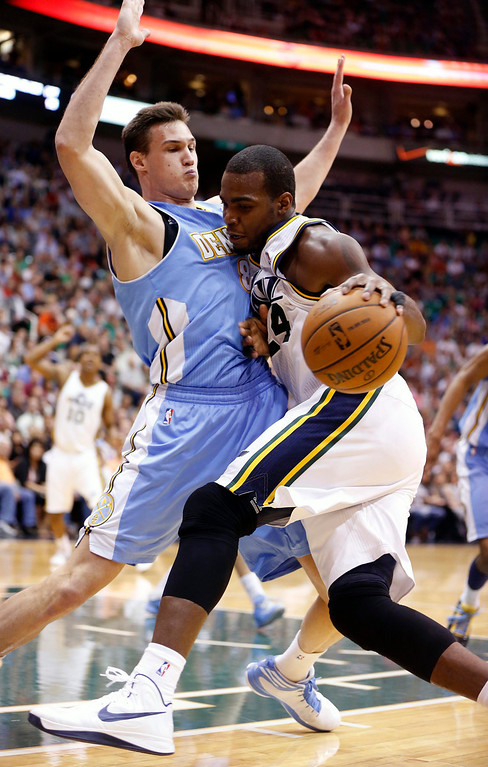 . Utah Jazz forward Paul Millsap (24) is defended by Denver Nuggets forward Danilo Gallinari (8) during the second half of their NBA basketball game in Salt Lake City, Utah, April 3, 2013. REUTERS/Jim Urquhart