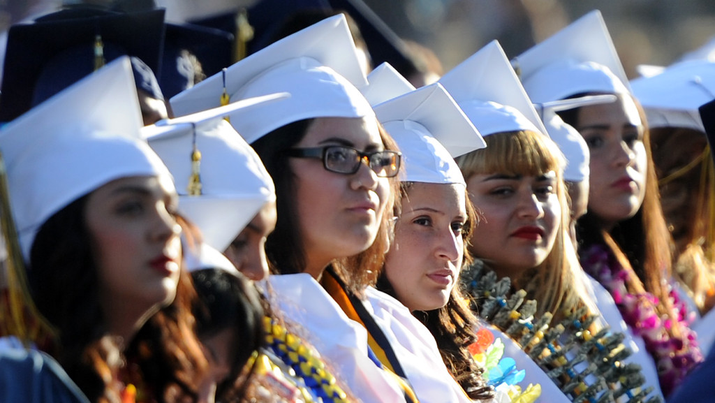 . Students listen to speeches during the Montebello High School commencement at Montebello High School on Thursday, June 20, 2013 in Montebello, Calif.  (Keith Birmingham/Pasadena Star-News)