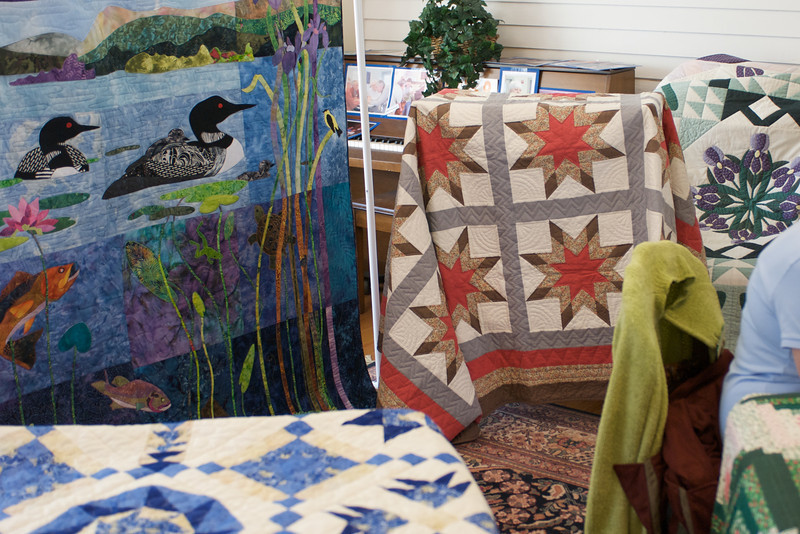 This star quilt (center) was one of her first.  She sold it at this quilt show (none of these were for sale, but a visitor was quite taken with it).