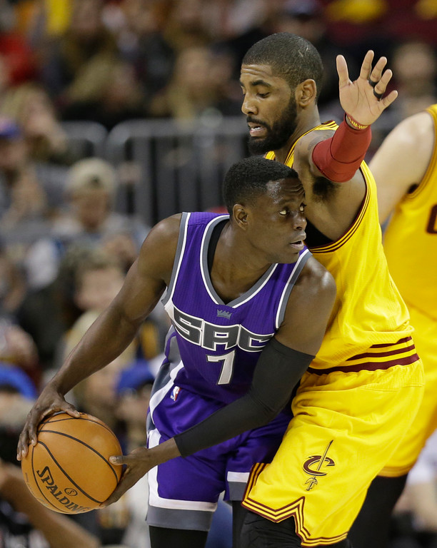 . Sacramento Kings\' Darren Collison (7) drives against Cleveland Cavaliers\' Kyrie Irving (2) in the first half of an NBA basketball game, Wednesday, Jan. 25, 2017, in Cleveland. (AP Photo/Tony Dejak)