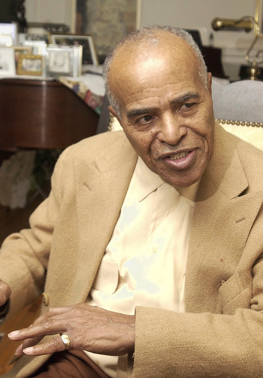 . FILE - In this Jan. 13, 2004 photo, Jazz singer Jon Hendricks talks about his career in jazz at his home in Toledo, Ohio, Hendricks, the pioneering jazz singer and lyricist who with the trio Lambert, Hendricks & Ross popularized the �vocalese� singing style in which words were added to instrumental songs, died Wednesday, Nov. 22, 2017. He was 96. (AP Photo/Tony Dejak, File)