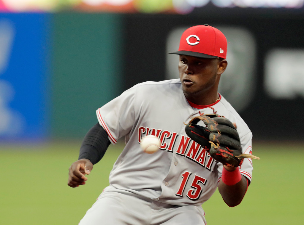 . Cincinnati Reds\' Dilson Herrera fields a ball hit by Cleveland Indians\' Tyler Naquin in the seventh inning of a baseball game, Tuesday, July 10, 2018, in Cleveland. Naquin was safe at first base on a fielders choice. (AP Photo/Tony Dejak)