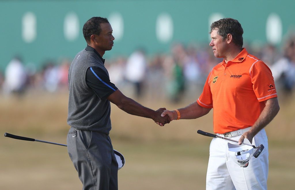 . Tiger Woods of the United States, left, shakes hands with Lee Westwood of England on the 18th green after their third round of the British Open Golf Championship at Muirfield, Scotland, Saturday July 20, 2013. (AP Photo/Scott Heppell)