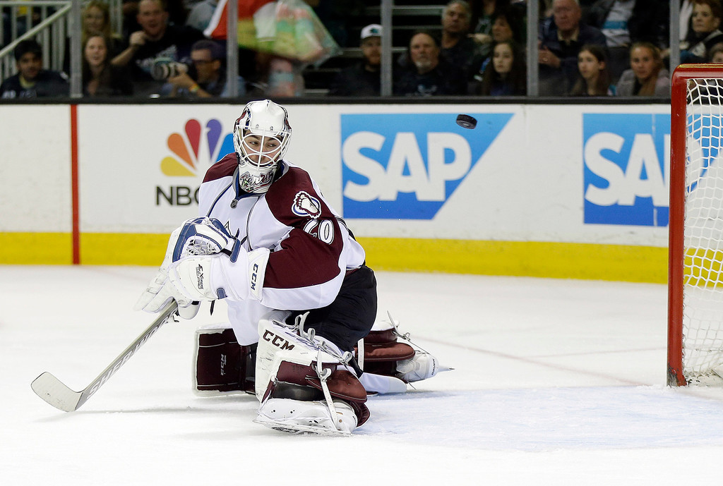 . Colorado Avalanche goalie Reto Berra, of Switzerland, is beaten for a goal  on a shot from San Jose Sharks\' Patrick Marleau during the first period of an NHL hockey game on Friday, April 11, 2014, in San Jose, Calif. (AP Photo/Marcio Jose Sanchez)