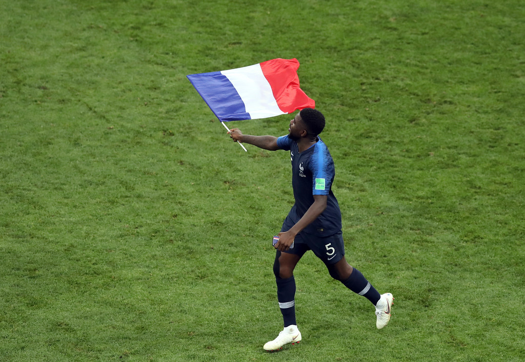. France\'s Samuel Umtiti celebrates at the end of the final match between France and Croatia at the 2018 soccer World Cup in the Luzhniki Stadium in Moscow, Russia, Sunday, July 15, 2018. (AP Photo/Thanassis Stavrakis)