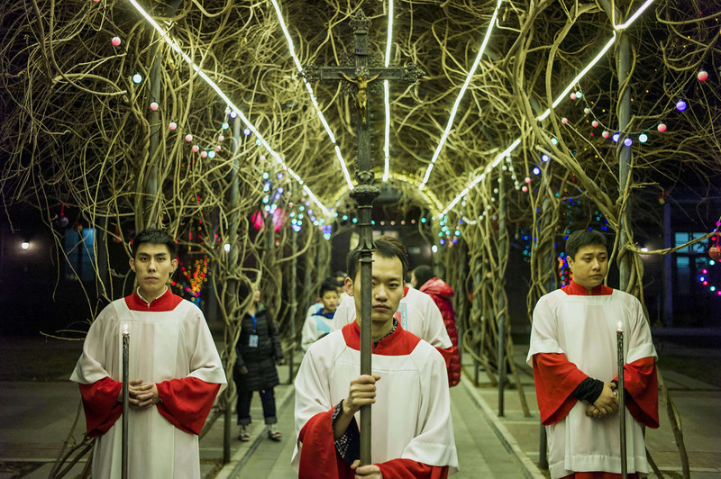 . Young Chinese worshippers attend the Christmas Eve mass at a Catholic church in Beijing on December 24, 2014 as Christians around the world prepare to celebrate the holy day.  FRED DUFOUR/AFP/Getty Images