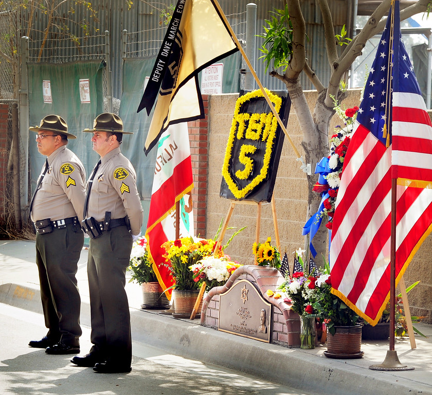. Deputies Sgt. Steven Ruiz, left, and Sgt. Mike Martinez Monday, April 29, 2013, once again stood in a 24-hour vigil on the site at Live Oak Avenue, near Peck road in Irwindale, where fellow Los Angeles County Deputy David March was gunned down during a traffic stop 11 years ago. March, 33, of Saugus was assigned to the Sheriff�s Temple Station when he was killed in the line of duty on April 29, 2002, on Live Oak Avenue near Peck Road in Irwindale. He was a 7-year veteran of the sheriff�s department and is survived by his wife, Teri, as well as a step-daughter. He was shot to death by Jorge Arroyo Garcia, also known as Armando Garcia, during what began as a routine traffic stop. Garcia, who was arrested in Mexico in 2006, was extradited to the U.S. to face trial in early 2007 and is now serving a life sentence in prison. When he was returned to the U.S. to face justice, fellow deputies cuffed him with March�s handcuffs. Every year since March�s death, fellow deputies have honored him with a 24-hour honor guard at the scene of his slaying, near a permanent plaque commemorating the sacrifice of the fallen deputy(SGVN/Photo by Walt Mancini)