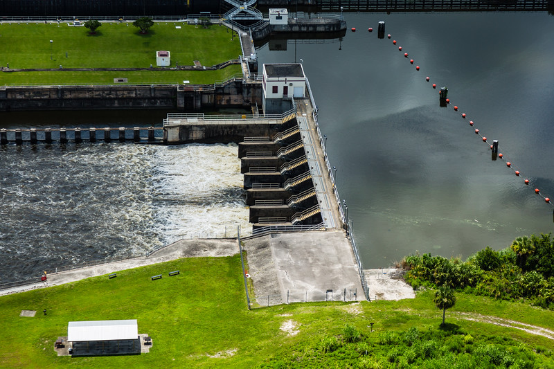 The S-80 discharge structure on the C-44 canal in Martin County on Friday July 8, 2016. The Army Corp of Engineers is pulsing water from the C-44 canal through the S-80 discharge structure to try and alleviate the aglae problem in the St. Lucie Estuary. (Joseph Forzano / The Palm Beach Post)