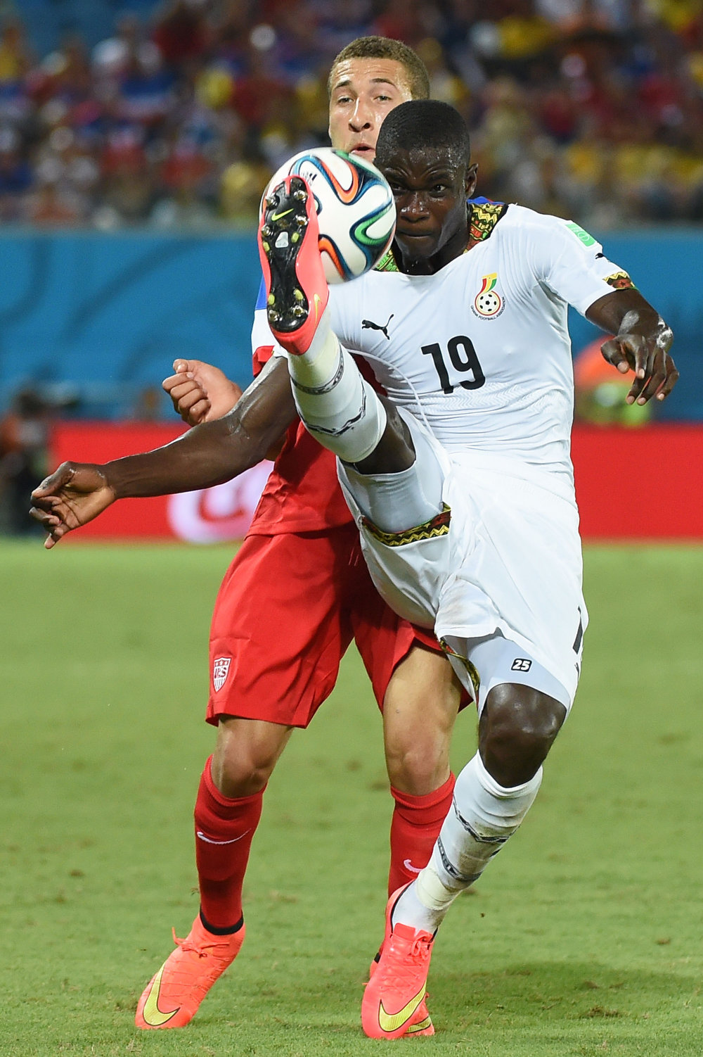 Description of . US defender Fabian Johnson (L) vies with Ghana's defender Jonathan Mensah (R) during a Group G football match between Ghana and US at the Dunas Arena in Natal during the 2014 FIFA World Cup on June 16, 2014.   AFP PHOTO / EMMANUEL DUNANDEMMANUEL DUNAND/AFP/Getty Images
