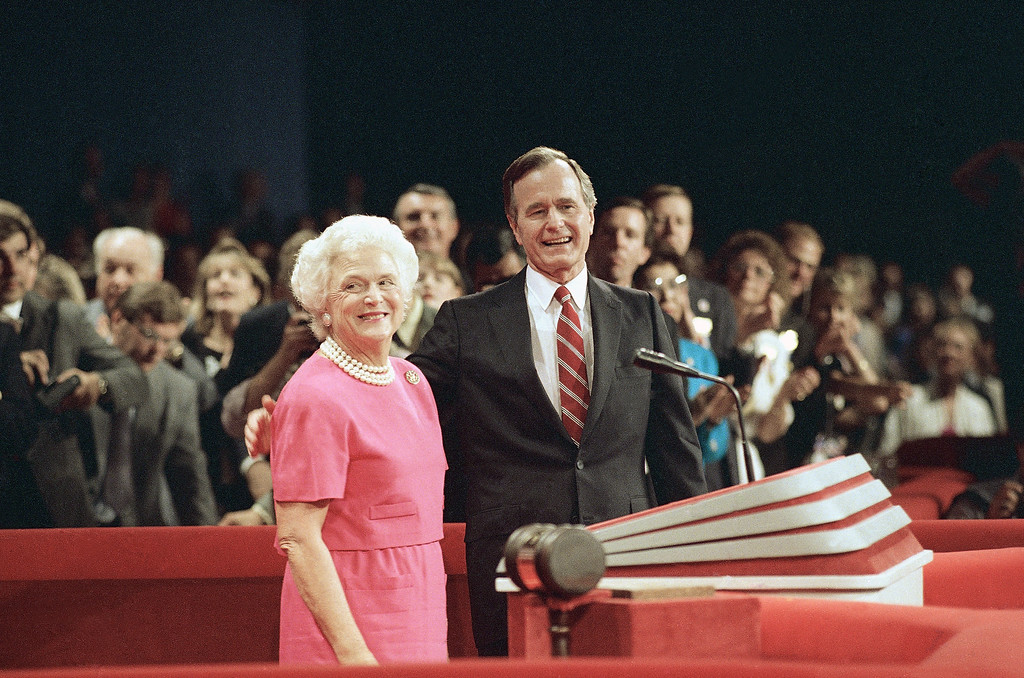 . Republican Presidential Nominee George H. W. Bush, right, at the podium of the Republican National Convention with wife Barbara Bush, Thursday, Aug. 18, 1988, New Orleans, La. (AP Photo/Mark Duncan)