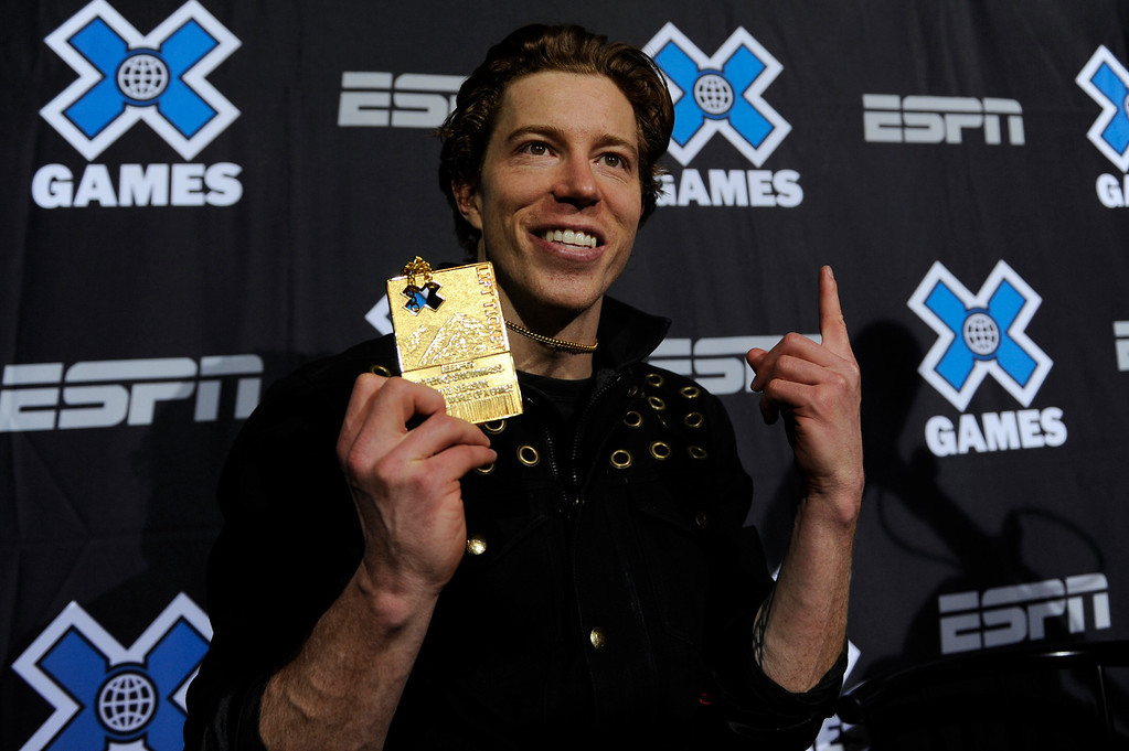 . ASPEN, CO - JANUARY 27: Shaun White shows his medal during a press conference after winning the men\'s superpipe event at Winter X Games Aspen 2013 at Buttermilk Mountain on Jan. 27, 2013, in Aspen, Colorado. White scored 98 points. (Photo by Daniel Petty/The Denver Post)