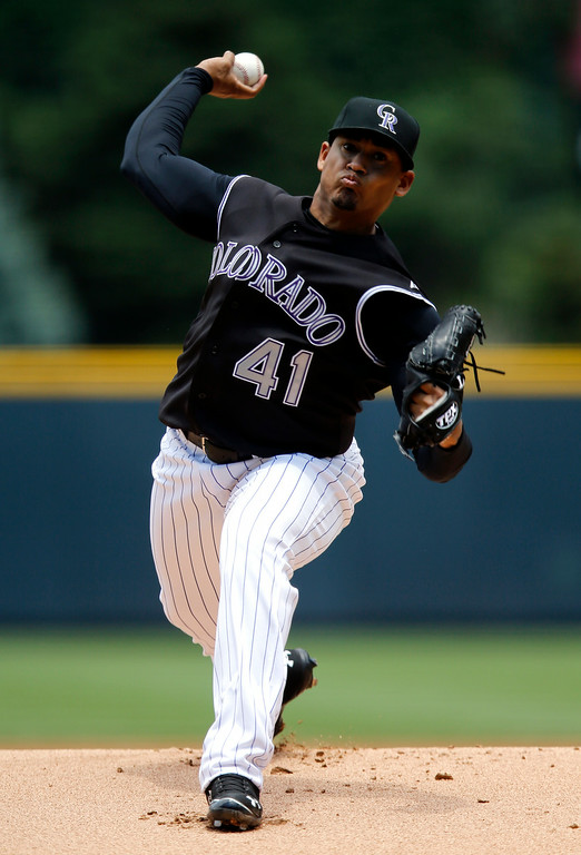 . Colorado Rockies starting pitcher Jair Jurrjens throws to the plate against the San Diego Padres during the first inning of a baseball game on Wednesday, July 9, 2014, in Denver. (AP Photo/Jack Dempsey)