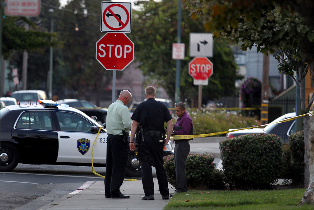 . Oakland police officers investigate the 58th homicide at Mandela Parkway and 10th Street in Oakland, Calif., on Friday, Aug. 2, 2013. (Ray Chavez/Bay Area News Group)