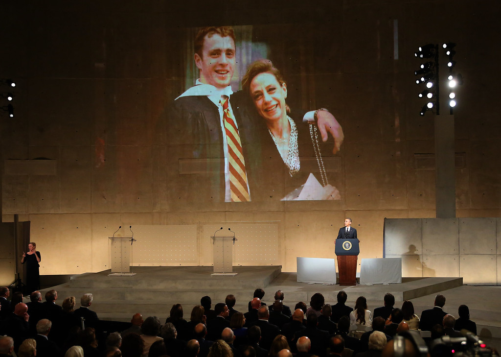 . U.S. President Barak Obama speaks about Welles Crowther, pictured on the screen with his mother Alison, during the dedication ceremony at the National September 11 Memorial Museum May 15, 2014 in New York City.  (Photo by Chang W. Lee-Pool/Getty Images)