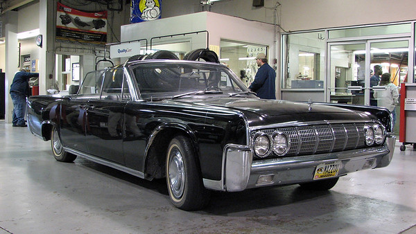 January 7 - 8, 2009:  Working on a 1964 Lincoln convertible .  .  .
