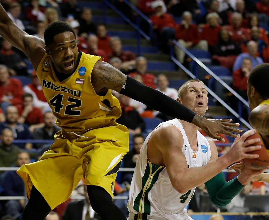 . Colorado State forward Pierce Hornung (4) shoots as Missouri forward Alex Oriakhi (42) defends during the first half their second-round NCAA college basketball tournament game on Thursday, March 21, 2013, in Lexington, Ky.  (AP Photo/John Bazemore)