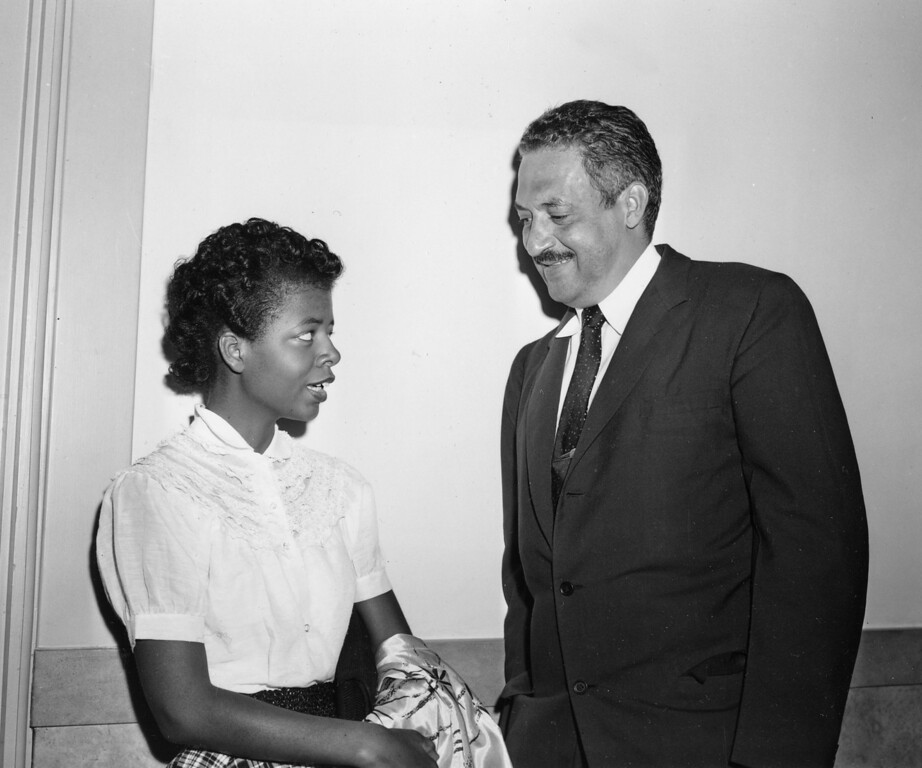 . Thurgood Marshall, right, chief legal counsel of the National Association for the Advancement of Colored People (NAACP), talks with student Elizabeth Eckford in the corridor of the Federal Courthouse at Little Rock, Ark., where a hearing on the integration case of Central High School is being held, Sepember 7, 1954. 15-year old Elizabeth was the first of nine black students to attempt to enter the school on opening day, only to be turned away by Arkansas National Guard troops following orders of Gov. Orval Faubus to block the main entrance. (AP Photo)