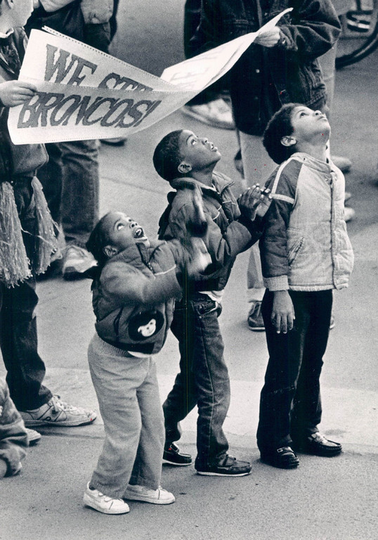 . JAN 27 1987 - Children at corner of Broadway and Cleveland Pl. watch the ticker tape Super Bowl Parade. (Susan Biddle/The Denver Post)