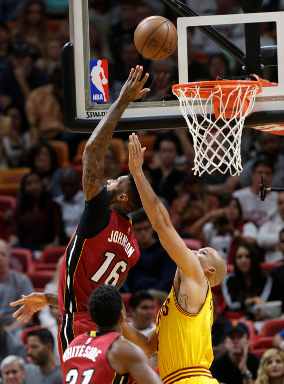 . Miami Heat\'s James Johnson (16) shoots over Cleveland Cavaliers\' Richard Jefferson during the first half of an NBA basketball game, Saturday, March 4, 2017, in Miami. (AP Photo/Lynne Sladky)
