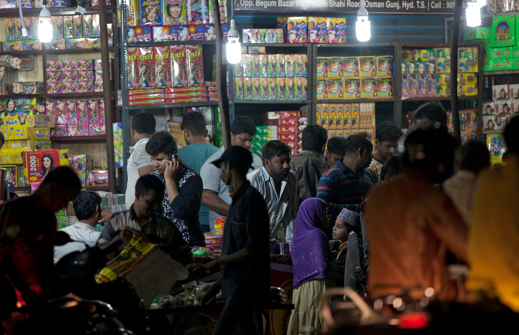 . Indians shop for firecrackers on a road side shop ahead of Diwali in Hyderabad, India, Wednesday, Oct. 18, 2017. Diwali, the Hindu festival of lights, will be celebrated on Oct. 19. (AP Photo/Mahesh Kumar A.)