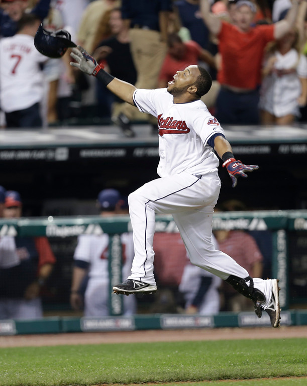 . Cleveland Indians\' Carlos Santana celebrates after rounding third base on his solo home run off Chicago White Sox relief pitcher Dylan Axelrod in the 10th inning of a baseball game, Wednesday, July 31, 2013, in Cleveland. The Indians won 6-5 in 10 innings. (AP Photo/Tony Dejak)