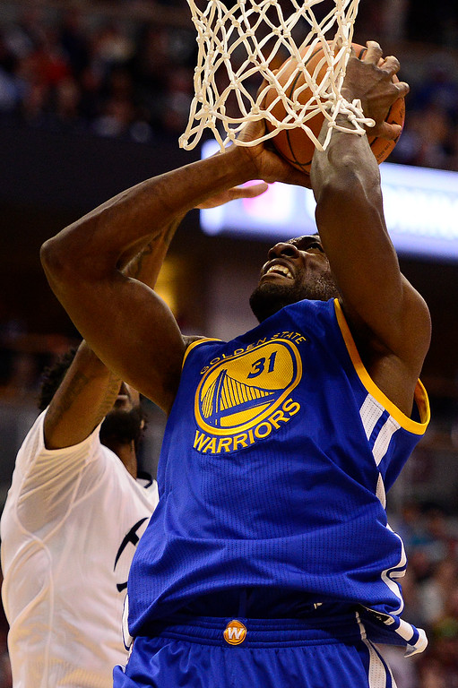 . DENVER, CO - JANUARY 13: Will Barton (5) of the Denver Nuggets blocks the dunk of Festus Ezeli (31) of the Golden State Warriors during the second half at the Pepsi Center on January 13, 2016 in Denver, Colorado. The Nuggets defeated the Warriors 112-110, giving the Warriors their third loss of the season. (Photo by Brent Lewis/The Denver Post)