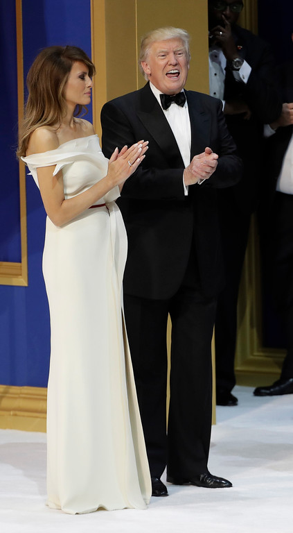 . President Donald J. Trump yells with the crowd as he waits with first lady Melania Trump before cutting a cake at The Salute To Our Armed Services Inaugural Ball Friday, Jan. 20, 2017, in Washington. (AP Photo/David J. Phillip)