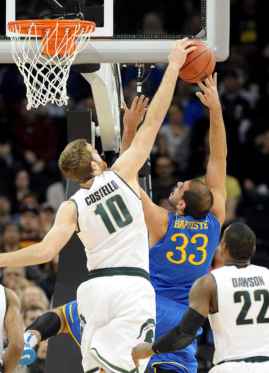 . Matt Costello #10 of the Michigan State Spartans blocks a shot taken by Carl Baptiste #33 of the Delaware Fightin Blue Hens during the second round of the 2014 NCAA Men\'s Basketball Tournament at Spokane Veterans Memorial Arena on March 20, 2014 in Spokane, Washington.  (Photo by Steve Dykes/Getty Images)