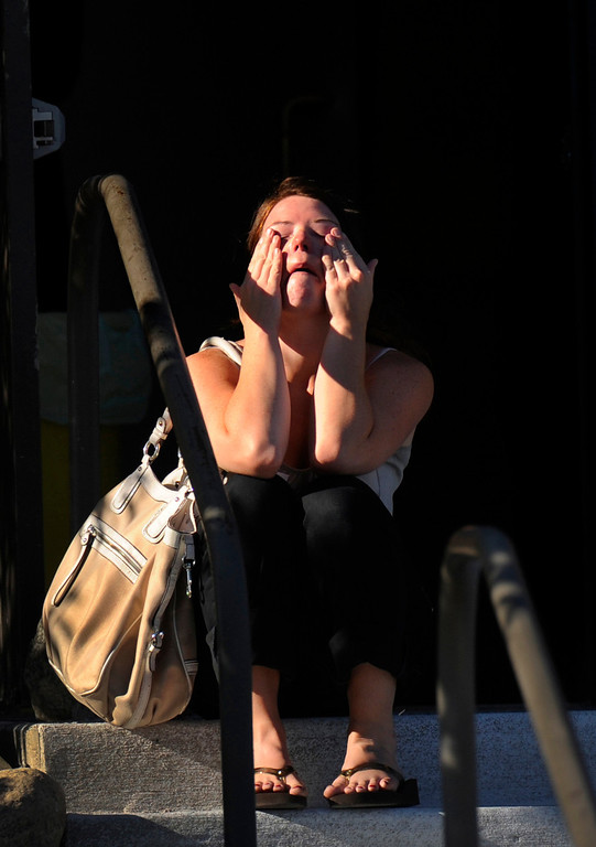 ". Amanda Medek wipes her tears outside Gateway High School while searching for her sister. Micayla Medek was still missing after the mass shooting inside an Aurora movie theater and would later be confirmed as one of the twelve victims. ""They can\'t find my sister,\"" Amanda said. \""She\'s not on any list. She was definitely shot. Her friend tried to drag her out. There were ten of them. She\'s the only one that didn\'t come out.\"" RJ Sangosti, The Denver Post"