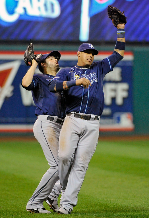 . Tampa Bay Rays left fielder David DeJesus, left, collides with shortstop Yunel Escobar as Escobar catches a pop-up off the bat of Cleveland Indians\' Jason Kipnis in the eight inning of the AL wild-card baseball game on Wednesday, Oct. 2, 2013, in Cleveland. (AP Photo/Phil Long)