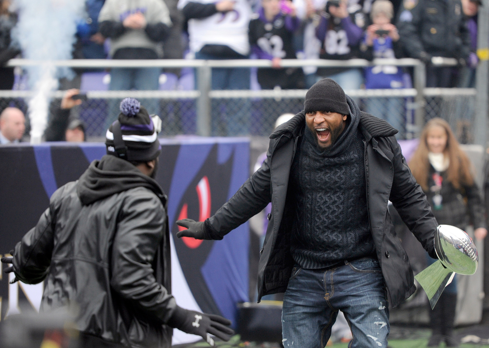 . Baltimore Ravens linebacker Ray Lewis, right, and safety Ed Redd dance during a championship celebration at the team\'s stadium in Baltimore, Tuesday, Feb. 5, 2013. The Ravens defeated the San Francisco 49ers in NFL football\'s Super Bowl XLVII 34-31 on Sunday. (AP Photo/Steve Ruark)
