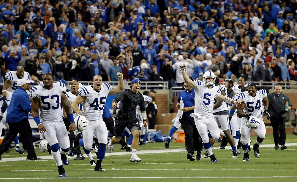 Description of . The Indianapolis Colts run onto the field after teammate Donnie Avery scored a touchdown in the closing seconds to defeat the Detroit Lions 35-33 in an NFL football game at Ford Field in Detroit, Sunday, Dec. 2, 2012. (AP Photo/Paul Sancya)
