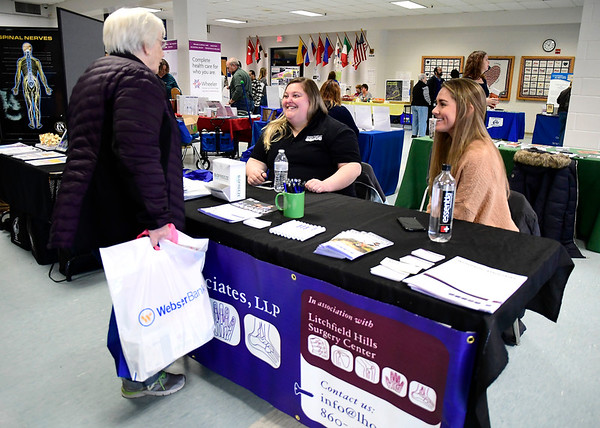 3/7/2020 Mike Orazzi | Staff Joan Mackie talks with Litchfield Hill Orthopedic Associates' Kendyl Holmes and Anna Lonardo during The Central Connecticut Chambers of Commerce's Family Health and Wellness Expo held at Bristol Eastern High School on Saturday.