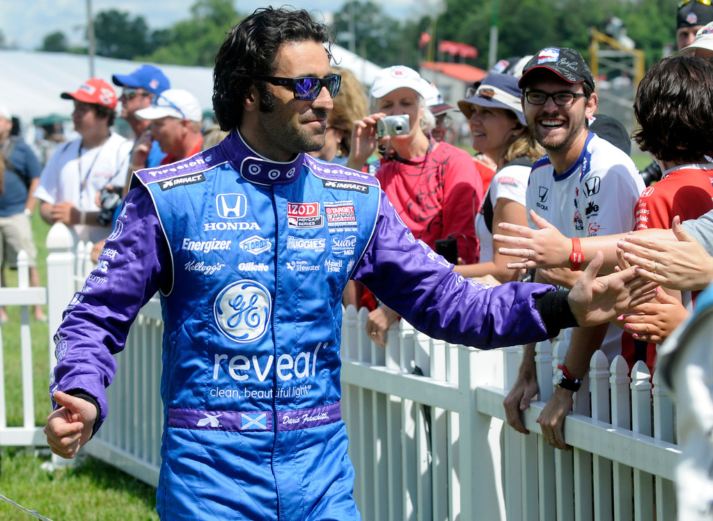. Dario Franchitti, of Scotland, is seen during driver introductions at the Honda Indy 200 at Mid-Ohio in Lexington, OH Sunday, Aug. 4, 2013. (AP Photo/Tom E. Puskar)