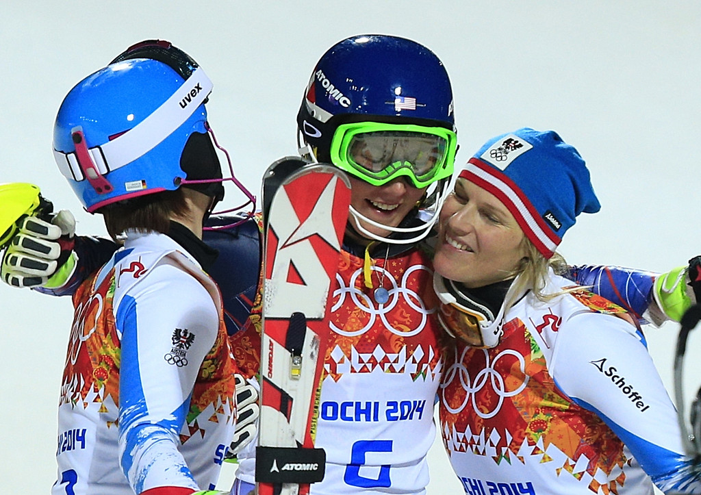 . (L-R) Bronze medallist Austria\'s Kathrin Zettel, gold medallist US skier Mikaela Shiffrin and silver medallist Austria\'s Marlies Schild celebrate after the Women\'s Alpine Skiing Slalom Run 2 at the Rosa Khutor Alpine Center during the Sochi Winter Olympics on February 21, 2014.      AFP PHOTO / ALEXANDER KLEIN/AFP/Getty Images