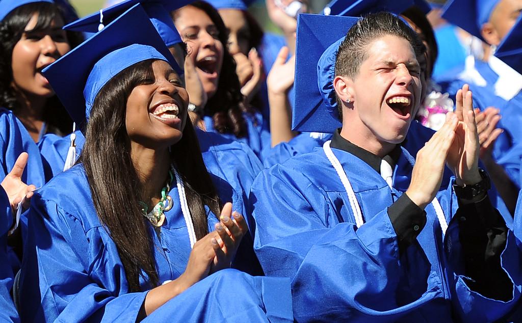 . Graduate Nashia Destiny Walton, left, reacts along with classmates during the El Camino High School commencement at El Camino High School on Wednesday, June 19, 2013 in Whittier, Calif.  (Keith Birmingham/Pasadena Star-News)