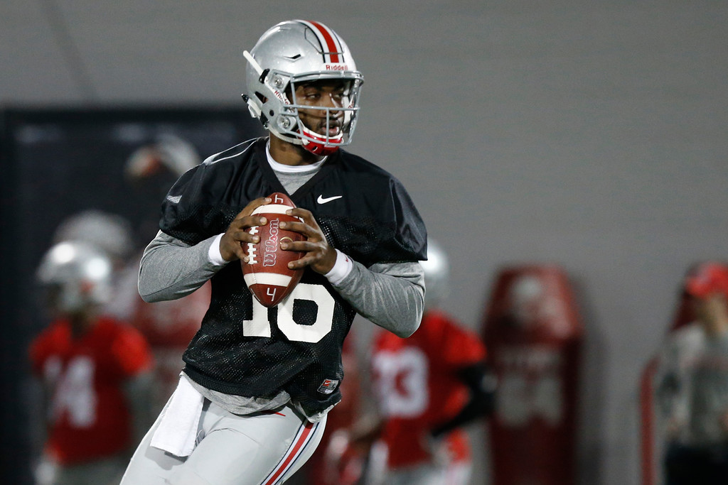 . Ohio State quarterback J.T. Barrett drops back to pass during spring NCAA college football practice Tuesday, March 7, 2017, in Columbus, Ohio. (AP Photo/Jay LaPrete)
