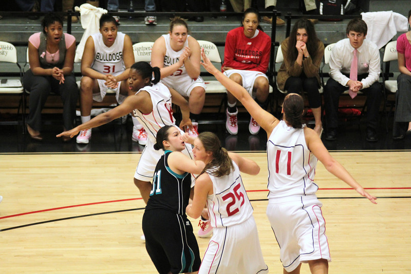 Several members of the GWU squad go for a rebound.