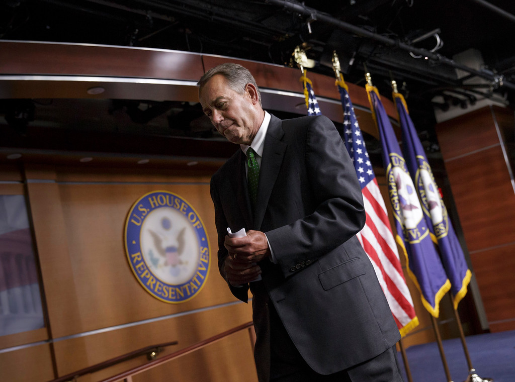 . House Speaker John Boehner of Ohio leaves after a news conference on Capitol Hill in Washington, Thursday, Sept. 11, 2014, to respond to the proposals from President Barack Obama about confronting the new wave of terrorism. On the anniversary of the 9/11 attacks, Republicans and Democrats in Congress voiced strong pre-election support Thursday for President Barack Obama\'s call for new authority to combat Islamic State militants in the heart of the Middle East. (AP Photo/J. Scott Applewhite)