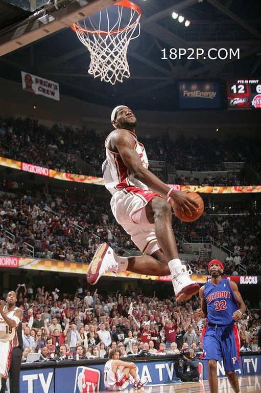 . CLEVELAND, OH - MAY 13:  LeBron James #23 of the Cleveland Cavaliers dunks against the Detroit Pistons in game three of the Eastern Conference Semifinals during the 2006 NBA Playoffs on May 13, 2006 at The Quicken Loans Arena in Cleveland, Ohio.  NOTE TO USER: User expressly acknowledges and agrees that, by downloading and or using this photograph, User is consenting to the terms and conditions of the Getty Images License Agreement. Mandatory Copyright Notice: Copyright 2006 NBAE (Photo by Jesse D. Garrabrant/NBAE via Getty Images) *** Local Caption *** LeBron James