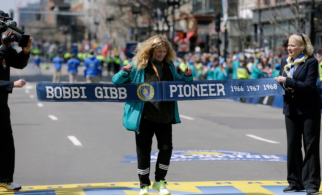 . Bobbi Gibb, first woman to run the Boston Marathon in 1966, crosses at the finish line of the 120th Boston Marathon on Monday, April 18, 2016, in Boston. (AP Photo/Elise Amendola)