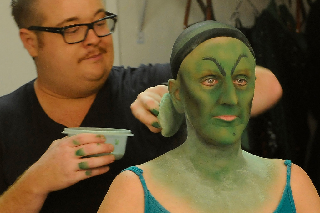 . A little powder puff us used to tone down the green. Jacquelyn Piro Donovan is transformed into the Wicked Witch by makeup artist Michael King. The Wizard of Oz is being staged at the Pantages Theatre in Hollywood, CA. 9/25/2013. photo by (John McCoy/Los Angeles Daily News)