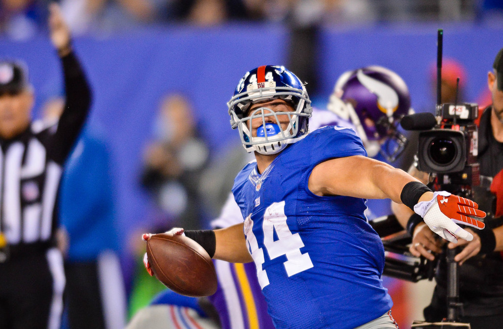 . Giants running back Peyton Hillis spikes the ball after scoring on a one-yard a touchdown run in the third quarter against the Vikings. (Pioneer Press: Ben Garvin)
