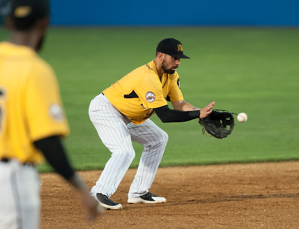 08/28/18 Wesley Bunnell | Staff The New Britain Bees vs the York Revolution on Tuesday night at new Britain Stadium. Shortstop Vicente Conde (4) fields, pivots and throws to second to start the double play.