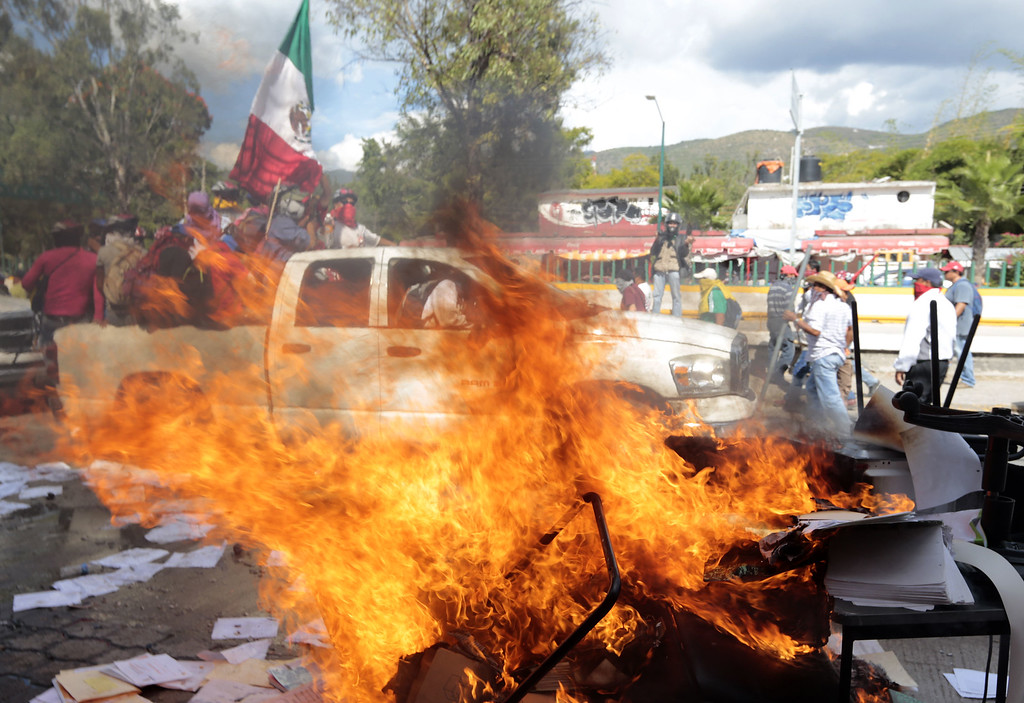 . Protesters set on fire the Education Secretararyship\'s Finance Office in Chilpancingo, Guerrero State, Mexico on November 12, 2014. Demonstrators angry over the disappearance of 43 college students set fire to the Guerrero state congress in southern Mexico on Wednesday in a new protest over the presumed massacre. Pedro PARDO/AFP/Getty Images